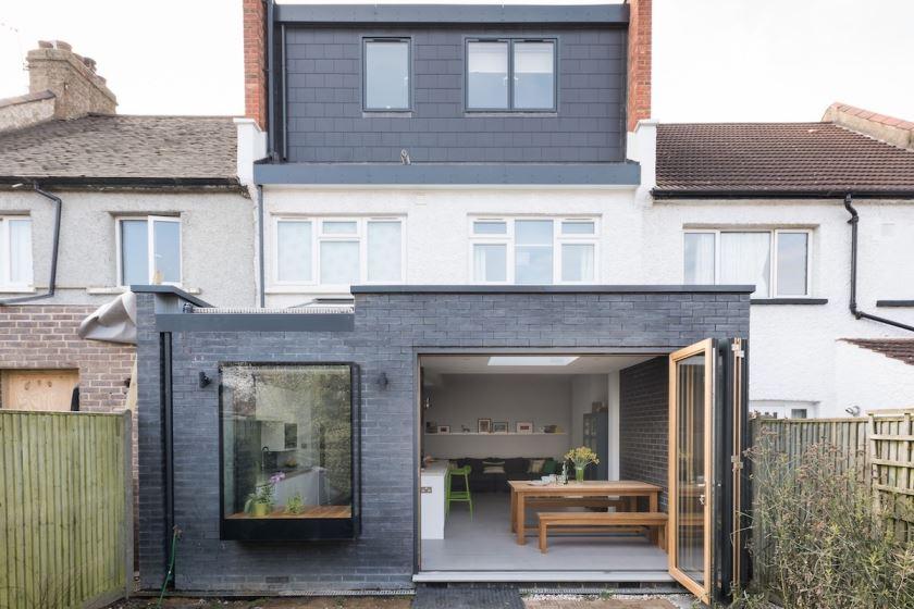 modern kitchen, concrete countertop, UFH, large format tiles, dark brick feature wall, loft conversion