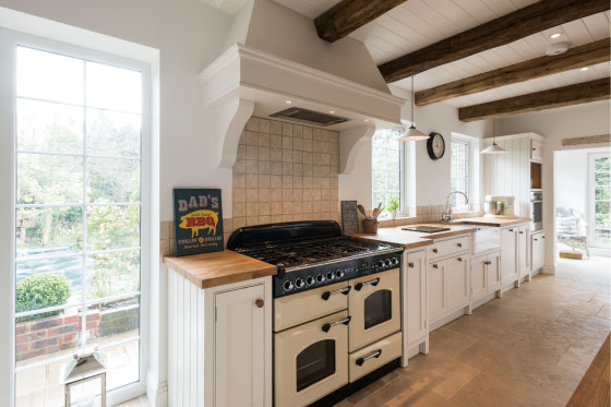 Traditional range cooker, wooden bespoke kitchen, wooden ceiling, oak beams