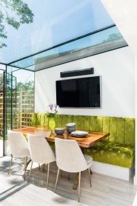 Bespoke luxury stylish kitchen, frame less glass box extension, Jacuzzi, moss wall