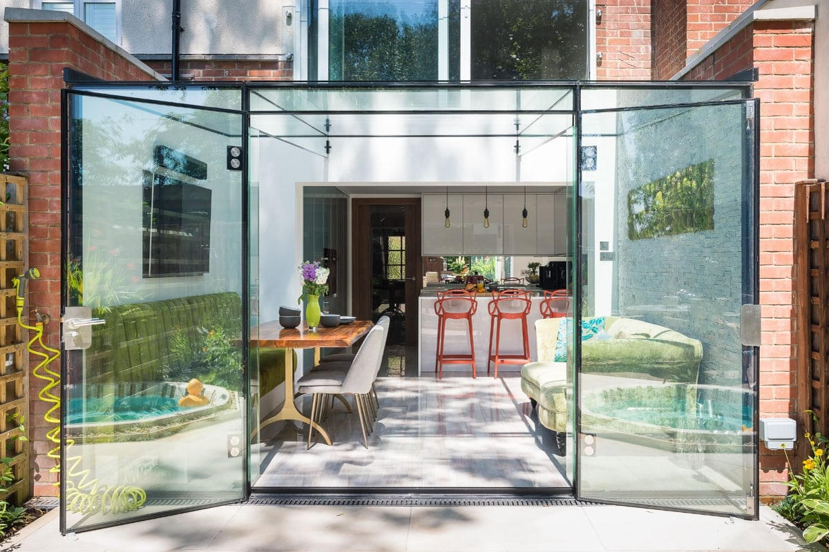 Bespoke luxury stylish kitchen, frame less glass box extension, Jacuzzi, moss wall