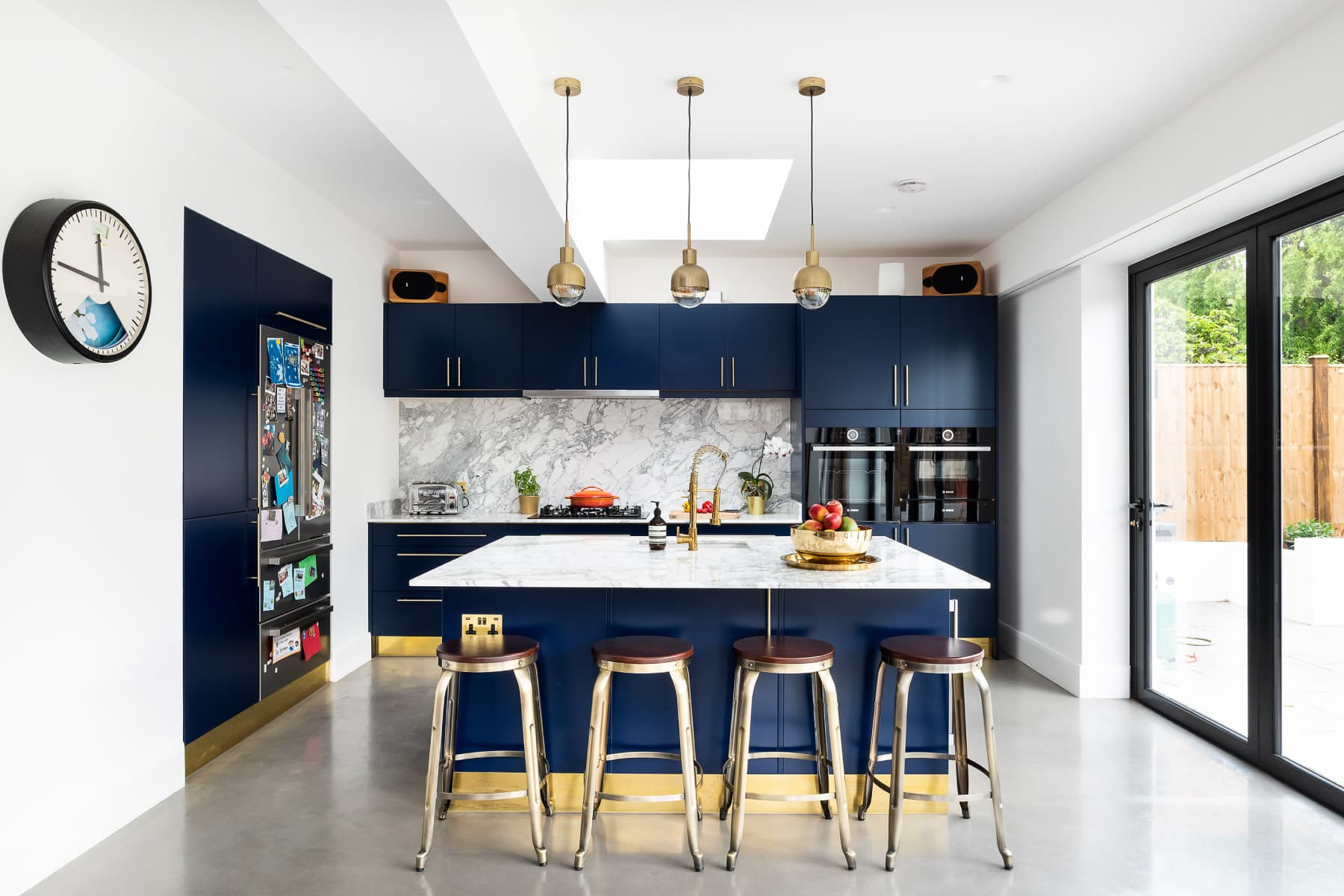 navy kitchen, polished concrete, brass fittings, marble